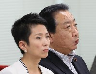 Democratic Party leader Renho, left, and Secretary-General Yoshihiko Noda are seen during a meeting of party lawmakers from both houses of the Diet at the party headquarters on July 25, 2017. (Mainichi)