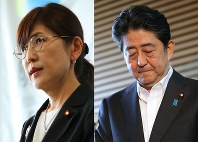 Defense Minister Tomomi Inada, left, and Prime Minister Shinzo Abe (Mainichi)