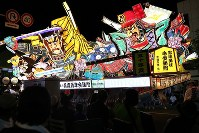 A giant float parades down the main street of Aomori during this year's Nebuta Festival on Aug. 2, 2017. (Mainichi)
