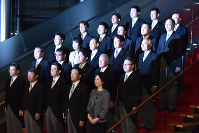 The new Cabinet of Prime Minister Shinzo Abe (front row, third from left) poses for commemorative photographs at the prime minister's office in Tokyo on Aug. 3, 2017. (Mainichi)