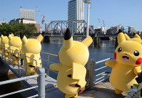 Pikachus greet people from a boat during the 2017