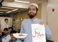 A Muslim student from Bangladesh is seen with a halal certificate the university cooperative association at Yamaguchi University received, on Aug. 3, 2017. (Mainichi)
