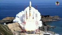 In this photo provided by the Japan Aerospace Exploration Agency (JAXA), an H-2A rocket carrying the Michibiki No. 3 global positioning system satellite lifts off from the Tanegashima Space Center in Kagoshima Prefecture, on Aug. 19, 2017.