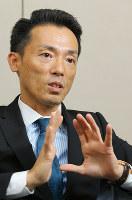 インタビューに答える神明の藤尾益雄社長=神戸市中央区で、菅知美撮影
