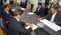 Okawa village assembly members deliberate the contents of a report saying that the municipal assembly can be maintained, in Okawa, Kochi Prefecture, on Aug. 18, 2017. (Mainichi)
