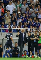 Japan manager Vahid Halilhodzic, center, celebrates in front of the bench after Japan scored the opening goal in its World Cup qualifying soccer match against Australia at Saitama Stadium on Aug. 31, 2017. (Mainichi)