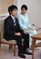 Princess Mako, right, and Kei Komuro are pictured in a news conference on their engagement at Akasaka Estate in the Motoakasaka district of Tokyo on the afternoon of Sept. 3, 2017. (Pool photo)