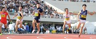Yoshihide Kiryu, center, competes in the men's 100-meter sprint at an intercollegiate meet at the Fukui Prefectural Athletic Park in Fukui on Sept. 9, 2017. (Mainichi)