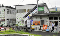 A temporary commercial complex is seen in Rikuzentakata, Iwate Prefecture. The tenant, Takata Osumi Tsudoi no Oka Shotengai, has decided to continue operating in the facility after taking it over from the municipal government. (Mainichi)