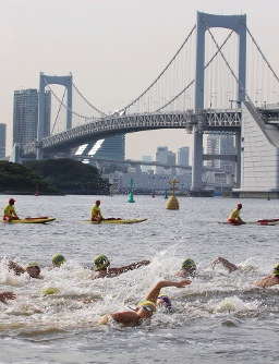 In this 2009 file photo, people swim at Odaiba Marine Park, the planned venue of the triathlon and open water swimming events at the 2020 Tokyo Olympics and Paralympics. (Mainichi)