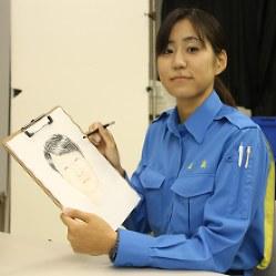 似顔絵を描く今村公子さん=県警本部で