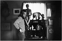 This digitized photograph captures James Dean at the home of photographer Sanford Roth. The original photo was taken by Roth and is part of a collection held by Seita Ohnishi. (C) 1987 by Seita Ohnishi