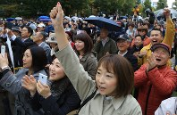 In this Oct. 12, 2017 file photo, people cheer during a political speech in Sapporo's Chuo Ward. (Mainichi)