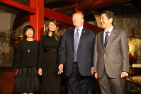 From right, Prime Minister Shinzo Abe, U.S. President Donald Trump, U.S. first lady Melania Trump, and Japanese first lady Akie Abe pose for a photo at a restaurant in the Ginza district of Tokyo's Chuo Ward on the evening of Nov. 5, 2017. (Pool photo)