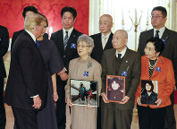 U.S. President Donald Trump, left, speaks to the families of Japanese abducted by North Korea during their meeting in Tokyo, on Monday, Nov. 6, 2017. Third from right is Sakie Yokota and second from right is Akihiro Arimura. (Kimimasa Mayama/Pool Photo via AP)