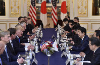 U.S. President Donald Trump, fourth from left, and Japanese Prime Minister Shinzo Abe, third from right, hold a meeting at Akasaka Palace in Tokyo Monday, Nov. 6, 2017. (Kazuhiro Nogi/Pool Photo via AP)