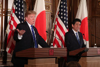 U.S. President Donald Trump, left, and Japanese Prime Minister Shinzo Abe address the press at a joint conference at Akasaka Palace in Tokyo, on Nov. 6, 2017. (Pool photo)