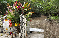 Flowers are laid at the site where a woman's body was found in May 2016 in the Okinawa Prefecture village of Onna in this photo taken on Nov. 16, 2017. (Mainichi)