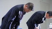 無資格検査問題の報告書を国交省に提出し、記者会見で陳謝する日産の西川広人社長=2017年11月17日、和田大典撮影