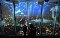 A projection mapping display is seen on the observation deck of the