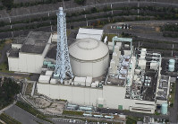 In this Oct. 20, 2017 file photo, the Monju prototype fast-breeder nuclear reactor is seen in Tsuruga, Fukui Prefecture. (Mainichi)