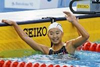 バルセロナ五輪競泳女子200メートル平泳ぎを中学2年で優勝し、笑顔をみせる岩崎恭子選手=スペインのバルセロナで1992年7月27日、伊藤俊文撮影