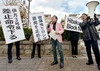 Lawyers hold up banners with messages such as,