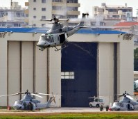 A helicopter takes off from U.S. Marine Corps Air Station Futenma in Ginowan, Okinawa Prefecture, on the morning of Dec. 14, 2017. (Mainichi)