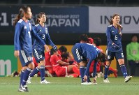 Nadeshiko Japan players react after North Koreans score second goal during E-1 Football Championship match at Fukuda Senshi Arena in Chiba on Dec.15, 2017.