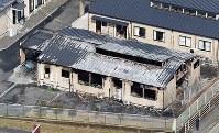 全焼し3人の遺体が見つかった障害者施設=愛媛県松野町で2017年3月12日、本社ヘリから平川義之撮影