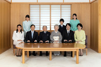Emperor Akihito, front row, third from left, Empress Michiko, front row, third from right, and other members of the Imperial Family are pictured in this photo provided by the Imperial Household Agency ahead of the New Year.