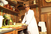 In this file photo, Momofuku Ando makes noodles in the recreation of his work space at the Cupnoodles Museum in Ikeda, Osaka Prefecture, on Nov. 2, 1999. (Mainichi)