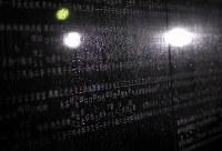 雨にぬれる犠牲者の名前が刻まれた慰霊碑=兵庫県西宮市の西宮震災記念碑公園で2018年1月17日午前5時4分、久保玲撮影
