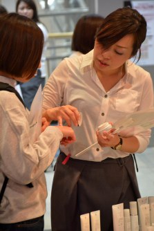 A Pola skincare consultant suggests a regimen to a visitor during an event at a mall in Takasaki, Gunma Prefecture, on Nov. 18, 2017. (Mainichi)
