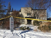 This Jan. 6, 2018 photo shows police crime scene tape marking off the property belonging to Barry and Honey Sherman, who were found strangled inside their home in Toronto on Dec. 15, 2017. (AP Photo/Rob Gillies)