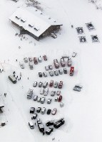 Emergency vehicles gathered around a rest house at Kusatsu Kokusai Ski Resort, located at the foot of Mount Kusatsu-Shirane, are seen from a Mainichi Shimbun helicopter in the town of Kusatsu, Gunma Prefecture, on Jan. 23, 2018. (Mainichi)
