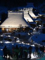 Houses with thatched roofs are lit up at Kayabukinosato village in the city of Nantan, Kyoto Prefecture, on Jan. 28, 2018. (Mainichi)