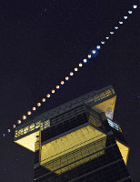 A total lunar eclipse is seen beside Oarai Marine Tower in the town of Oarai, Ibaraki Prefecture. The photo is composed of 29 pictures taken in 5 minute intervals from Jan. 31 through Feb. 1, 2018. (Mainichi)