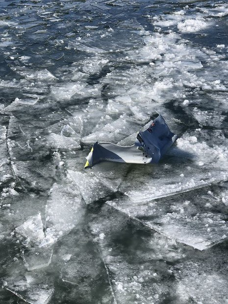 Metallic debris from external fuel tanks dumped by a U.S. F-16 fighter jet is seen on an ice-covered part of Lake Ogawara, in Tohoku, Aomori Prefecture, on Feb. 20, 2018. (Photo courtesy of the Lake Ogawara fisheries cooperative)