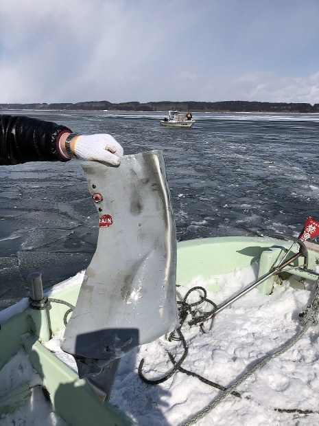 In this photo provided by the Lake Ogawara fisheries cooperative, a piece of metal that fell from a U.S. F-16 fighter plane stationed at Misawa Air Base is seen on Feb. 20, 2018, at Lake Ogawara in Aomori Prefecture.