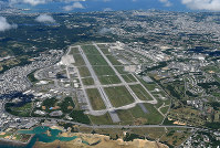 The U.S. military's Kadena Air Base is pictured in Kadena, Okinawa Prefecture, in this file photo taken from a Mainichi aircraft on July 23, 2017. (Mainichi)