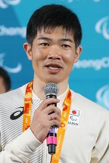 記者会見で質問に答える新田佳浩選手=韓国・平昌で2018年3月8日、宮武祐希撮影