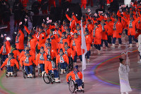 Team Japan makes their entrance led by flagbearer and alpine skier Momoka Muraoka during the opening ceremony for the Paralympic Winter Games in the Olympic Stadium in Pyeongchang, South Korea, on March 9, 2018. (Mainichi)