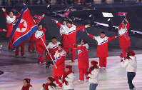 Team North Korea makes their entrance during the opening ceremony for the Paralympic Winter Games in the Olympic Stadium in Pyeongchang, South Korea, on March 9, 2018. (Mainichi)