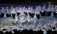 A wheelchair performance is seen during the Paralympic Winter Games opening ceremony in the Olympic Stadium in Pyeongchang, South Korea, on March 9, 2018. (Mainichi)