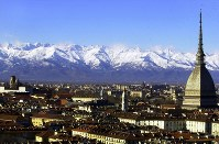 A view of Turin, Italy, with the main city landmark, the Mole Antonelliana, at right, and the Alps in the background are seen in this December 2005 photo. Milan and Turin are in discussions with the Italian Olympic Committee over a possible bid for the 2026 Winter Games. (AP Photo/Massimo Pinca)