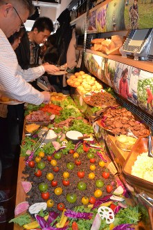 Participants make homemade hamburgers using ingredients from Fukushima Prefecture in Tokyo's Shibuya Ward, on March 18, 2018. (Mainichi)