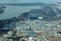 This file photo taken on March 27, 2011, shows a spent nuclear fuel reprocessing plant operated by Japan Nuclear Fuel Ltd. in Rokkasho, Aomori Prefecture. (Mainichi)