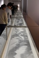 People view works at a special exhibition titled