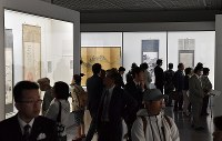 Many visitors view works at a special exhibition titled
